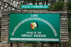 Sign with the long form alternate name for Lake Chaubunagungamaug that also acknowledges the Nipmuck presence in the town.
