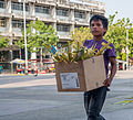 Child selling sacred palm for Palm Sunday.jpg