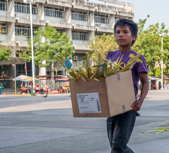 File:Child selling sacred palm for Palm Sunday.jpg