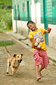 Children playing with a dog.jpg
