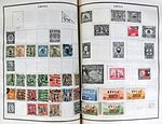 Chinese postage stamps on album pages.jpg
