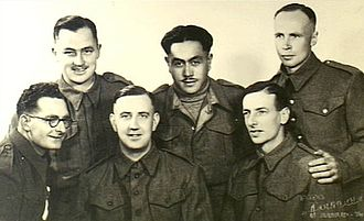 "Raid at Ožbalt - Ralph Churches (left rear) with five other Commonwealth POWs prior to the escape. The other two men at the rear and the man at the right front (""Kit"" Carson, 6th Australian Division) were all part of the successful escape party"