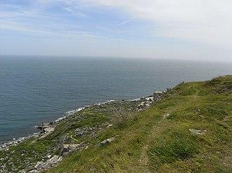 Durdle Pier - Cliff path above Durdle Pier (seen bottom left).