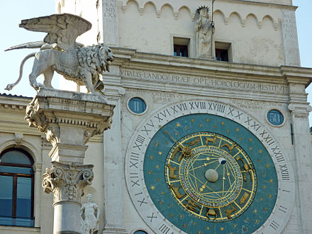 Clock tower and Lion of St. Mark, symbol of the Serenissima Repubblic Clock tower and Lion of St. Mark in Padova - just like the ones in Venice.jpg