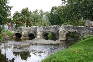 River Clun, Shropshire - The river flowing through the town of Clun, in which the historic packhorse bridge is still the only vehicle-carrying bridge.