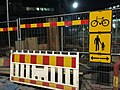 Construction fence with detours for bikes and pedestrians (27181843627).jpg
