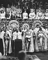 Black-and-white photograph of large altar dishes standing on a table in front of the royal box during a coronation