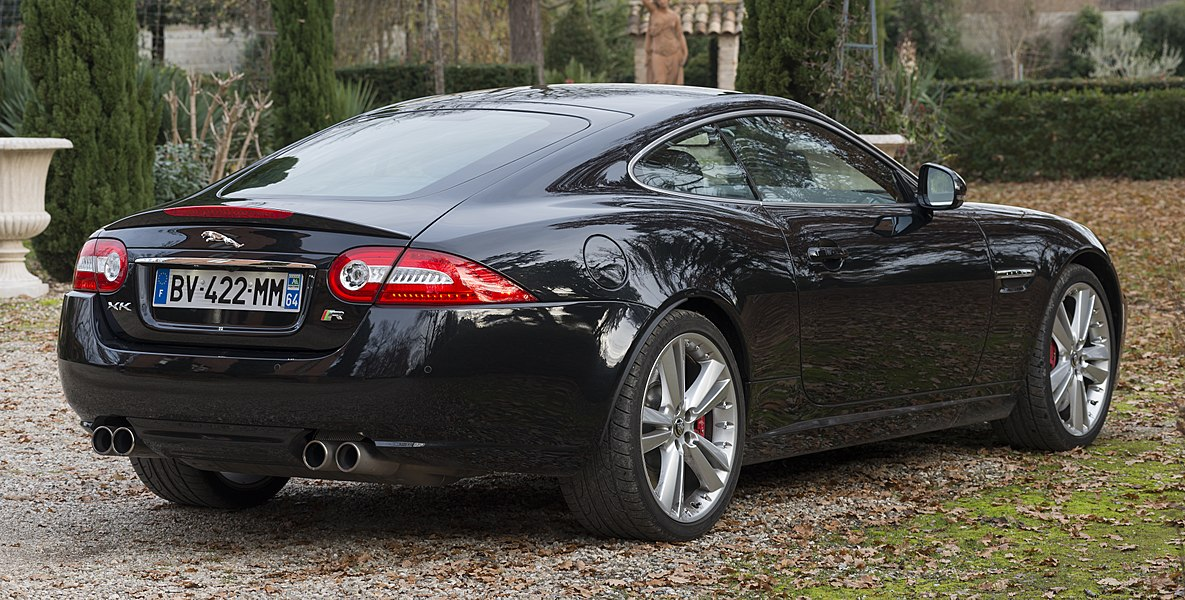 English:  Jaguar XKR (X150) Coupé Model 2014. 3/4 rear view.