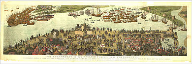 A naval battle close to land with opposing fleets on either side with tops of two masts protruding from the water, indicating the sunken Mary Rose
