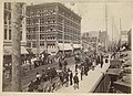 Crowd watching a circus parade on Second Avenue, Seattle, circa 1900 (MOHAI 9684).jpg