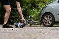 Cyclist picks up helmet after bike accident.jpg