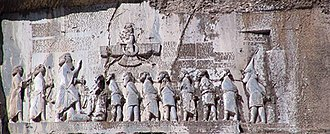 Punishments of captured rebels against Achamenied dynasty is recorded in Behistun Inscription by King Darius which contains mutilation and Impaling the captives, Leaders of the rebellions from different colonies of ancient Persia are shown in chains from neck to legs, Gaumata lays under the boot of Darius Darius I the Great's inscription (cropped).jpg