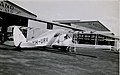 De Havilland DH.84 Dragon aeroplane VH-URV outside hangar, 1930 - 1939.jpg