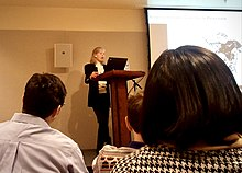 Rhode giving a presentation in 2011
