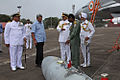 Defence Minister Manohar Parikkar being briefed by Capt Theophilis, Commanding Officer INAS 303 about Mig 29K fighter aircraft.JPG