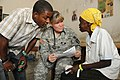 Defense.gov News Photo 100430-A-1526R-119 - U.S. Army Capt. Leslie Snowden-Crawford 2nd from right a nurse with 94th Combat Support Hospital out of Seagoville Texas evaluates an elderly.jpg