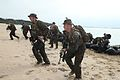 Defense.gov News Photo 120113-M-UY543-004 - Marines with Company A Battalion Landing Team 1st Battalion 4th Marines 31st Marine Expeditionary Unit run up the Kin Blue training area beach.jpg
