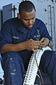 Defense.gov News Photo 120128-N-JE709-051 - U.S. Navy Seaman Jonathon Foreman splices a tattletale through a new mooring line aboard aircraft carrier USS George H.W. Bush CVN 77 in the.jpg