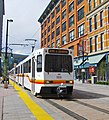 Denver light rail train at 16th-California station.jpg