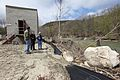 Director Dan Ashe views damage at the hatchery along the White River. (6978270178).jpg