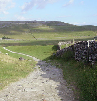 Yorkshire Dales National Park - Limestone hills and dry-stone walls in the west of the Yorkshire Dales. This part of the national park is popular with walkers due to the presence of the Yorkshire three peaks.