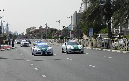 Dubai Police super-car motorcade at Jumeirah Road Dubai Police at work (12385410394).jpg