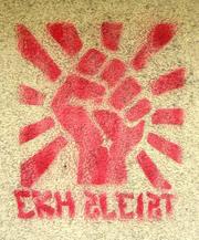 Raised fist, stenciled protest symbol of Autonome at the Ernst-Kirchweger-Haus in Vienna, Austria