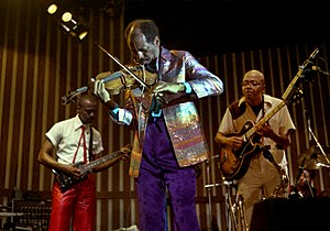 Of Human Feelings - Coleman (middle), accompanied by guitarists Charlie Ellerbee (left) and Bern Nix (right)