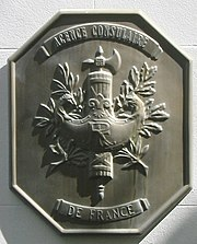 The symbol is used on plaques marking French consulates