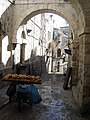 Empty street at Jerusalem old city with a stand of bread.jpg