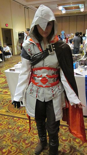 A cosplayer portraying Ezio from Assassin's Cr...