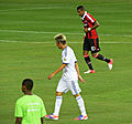 Fábio Coentrão and Kevin-Prince Boateng, August 2012.jpg