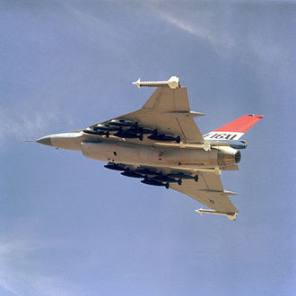 General Dynamics F-16XL - An air-to-air left underside view of an F-16XL aircraft. The aircraft is armed with two wingtip-mounted AIM-9 Sidewinder and four fuselage-mounted AIM-120 AMRAAM missiles along with 12 Mark 82 500-pound bombs.