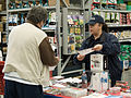 FEMA - 34323 - FEMA Mitigation specialist speaking to a resident at a local hardware store in Tennessee.jpg