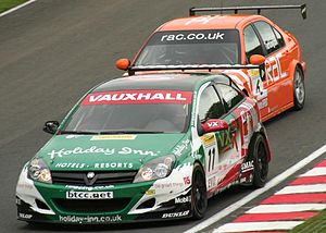 Oulton Park - Fabrizio Giovanardi (leading Colin Turkington) driving for Vauxhall at the Oulton Park round of the 2006 British Touring Car Championship