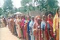 Female voters at a long queue in front of a polling booth at Morangi in Hazaribagh Parliamentary Constituency of Jharkhand during the first phase of General Elections-2004 on April 20, 2004.jpg