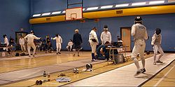 Fencing Tournament. (Note the grounded conductive strips on the floor.)