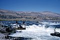 Fishermen at Celilo Falls on the Columbia River (3229038197).jpg