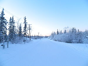 Fort Yukon, Alaska - Fort Yukon village street on the Winter Solstice, before sunrise at 11:30 am.