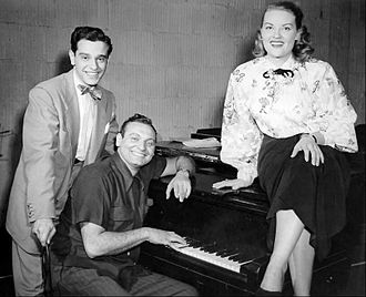 1950s in music - Frankie Laine (at piano) and Patti Page, circa 1950.