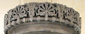 "Allahabad pillar - Frieze of the lost capital of the Allahabad pillar, with two lotuses framing a ""flame palmette"" surrounded by small rosette flowers."