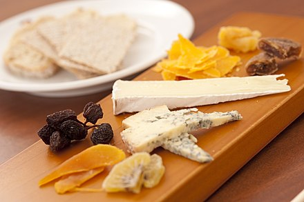Some French cheeses with fruits Fromages francais (19387655209).jpg