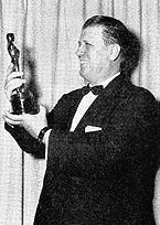 George Stevens hauldin his Oscar for Giant.