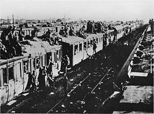 Train surfing - German demobilisation, Western Front, 1918. Soldiers cling on to the roofs and doors of a train already full of other troops.