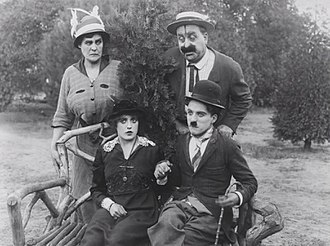 Phyllis Allen - Clockwise from top: Phyllis Allen, Mack Swain, Charles Chaplin, and Mabel Normand in Getting Acquainted (1914)