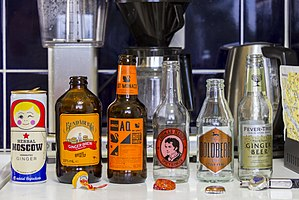 Ginger beer - Assortment of ginger beer bottles containing Moscow Herbal, Bundaberg, Aqua Monaco, Thomas Henry, Goldberg and Fever-Tree bottles.