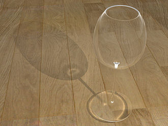 Photon mapping - A model of a wine glass ray traced with photon mapping to show caustics.