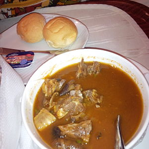 Goat meat pepper soup - Goat meat pepper soup served with bread