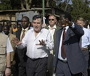 Gordon Brown touring the slums of Nairobi, Kenya in 2005