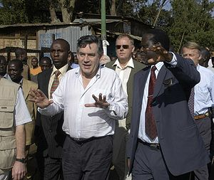 Gordon Brown touring the slums of Nairobi, Ken...